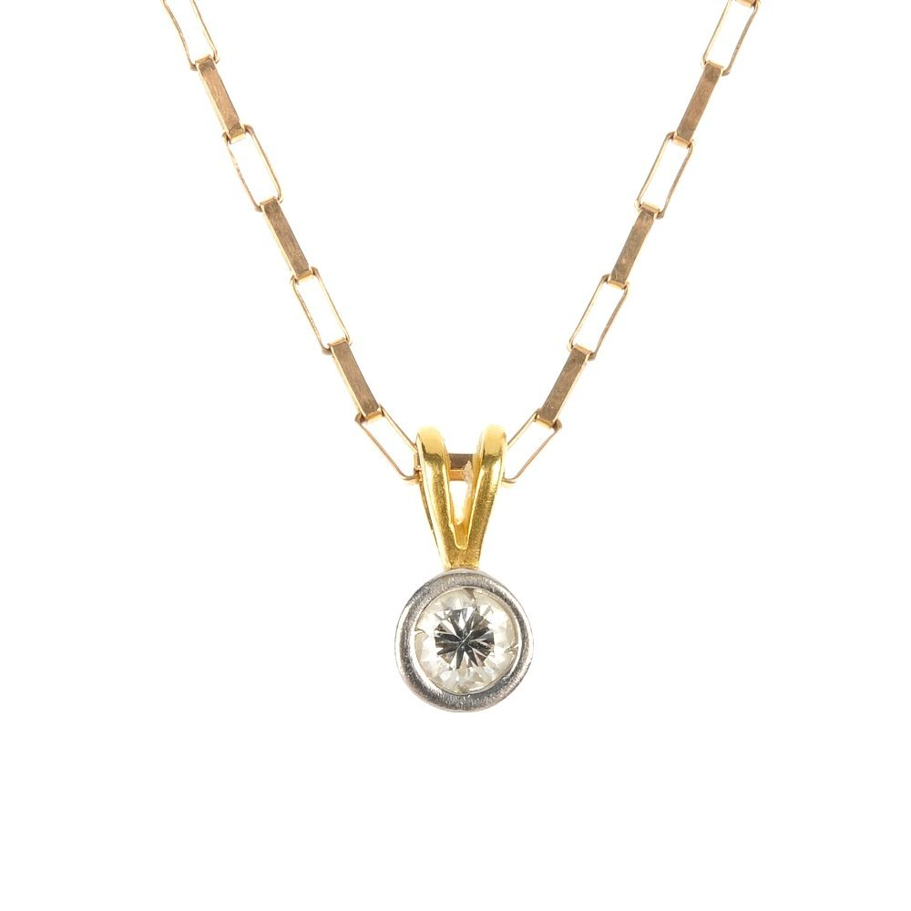 An 18ct gold diamond pendant and a 9ct gold garnet dres