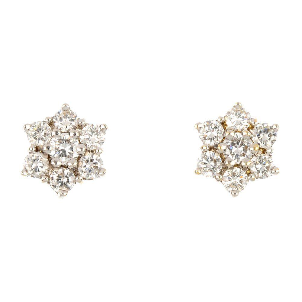 (80147) A pair of 18ct gold diamond ear studs.