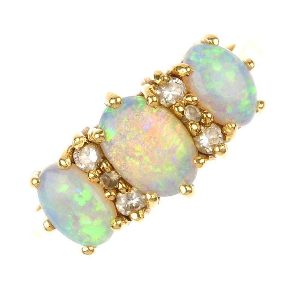 An 18ct gold opal and diamond ring.