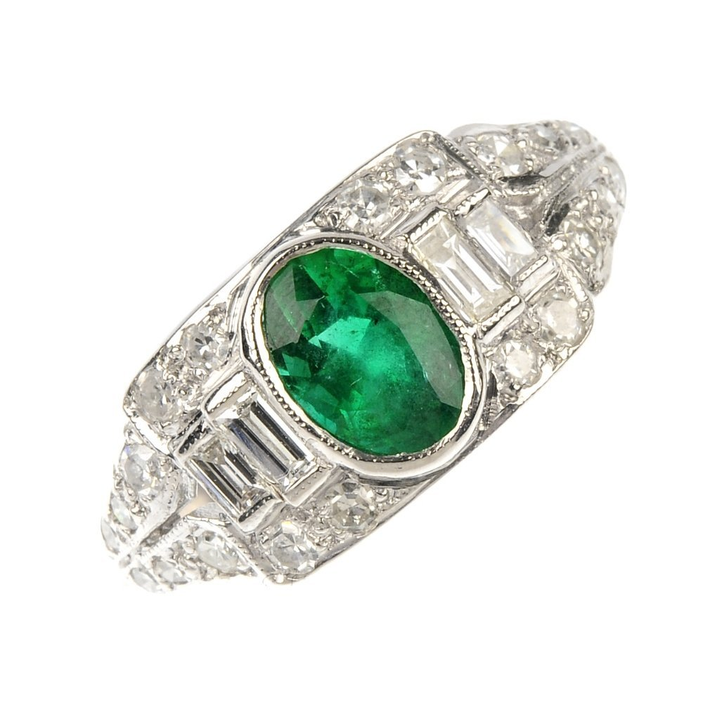 An emerald and diamond dress ring.