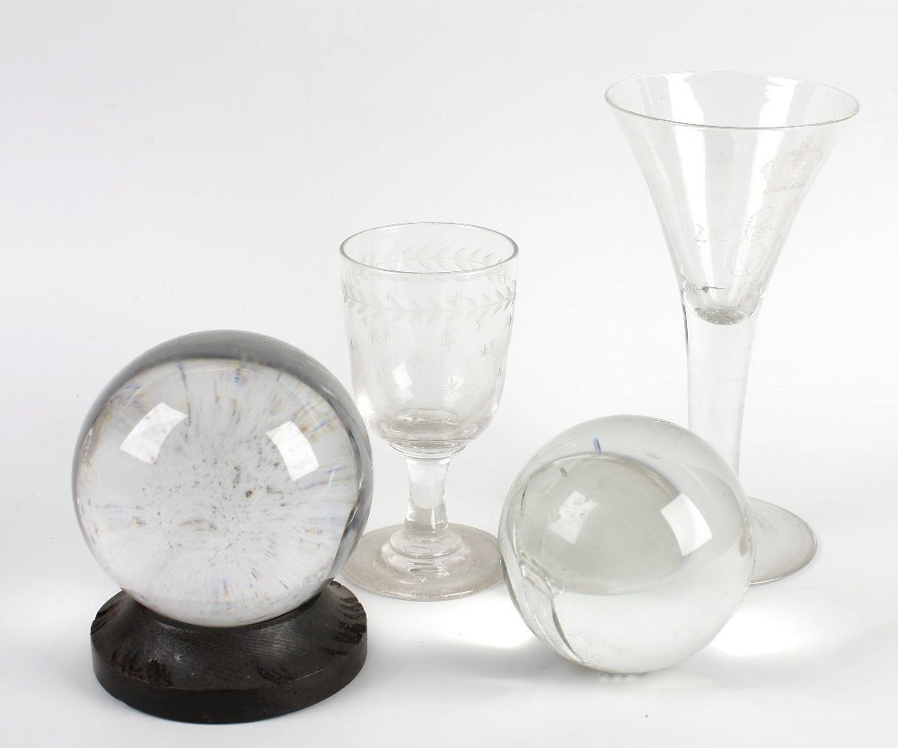 Two crystal balls and a Whitefriars drinking glass