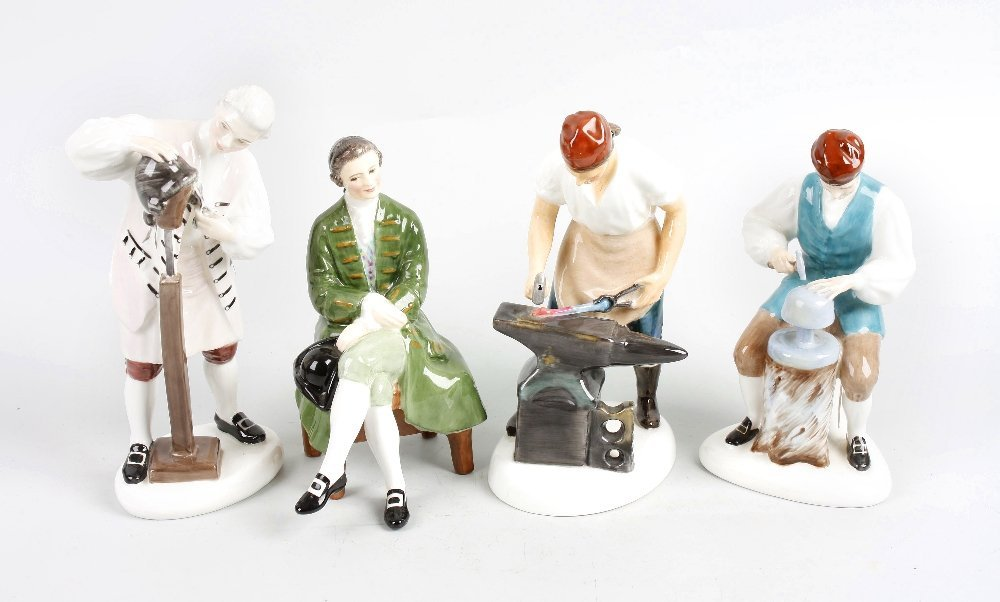 A collection of four Royal Doulton figurines