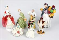 A collection of eight Royal Doulton figures to include