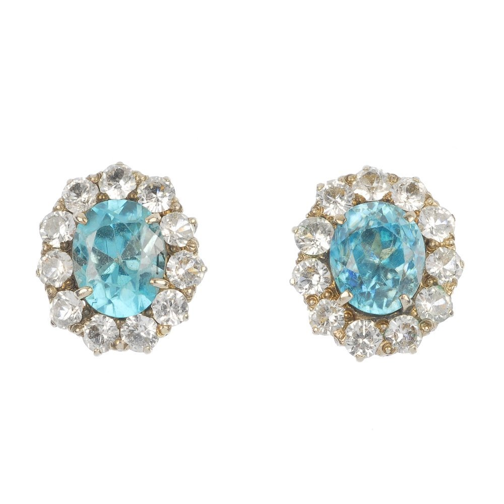 A pair of zircon and colourless gem ear studs.