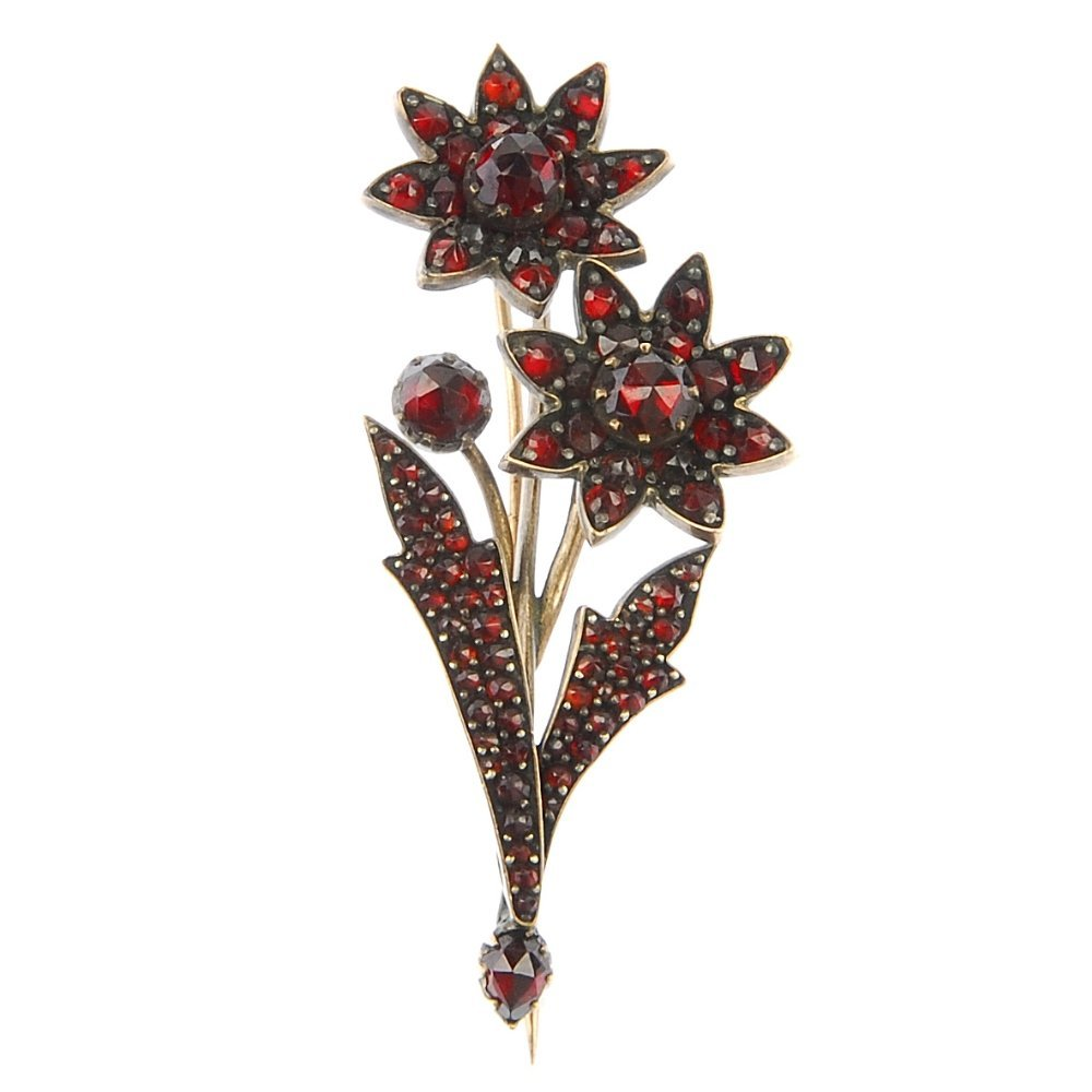 A late 19th century garnet and red paste floral brooch.