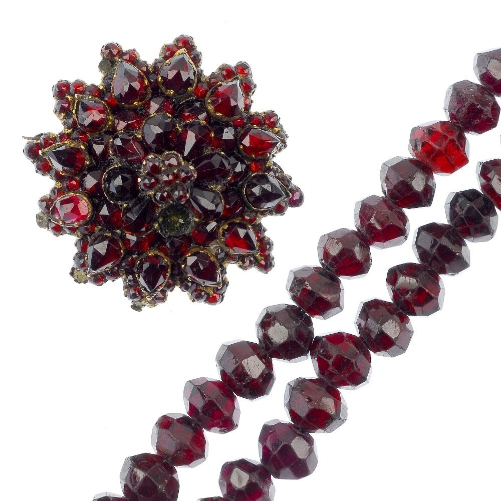 A late 19th century red paste brooch and garnet