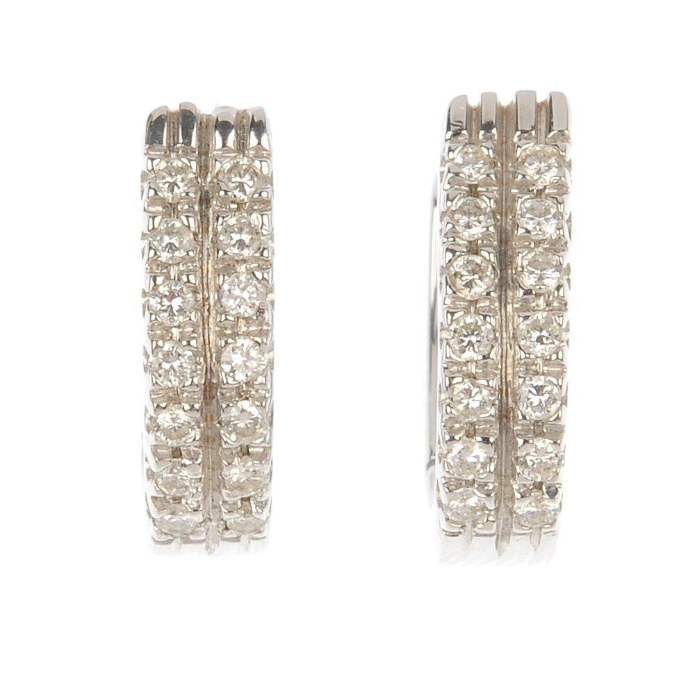 A pair of diamond hinged ear hoops.