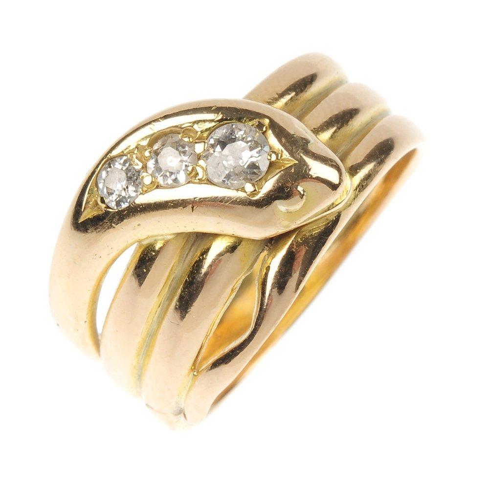 An Edwardian 18ct gold diamond snake ring.