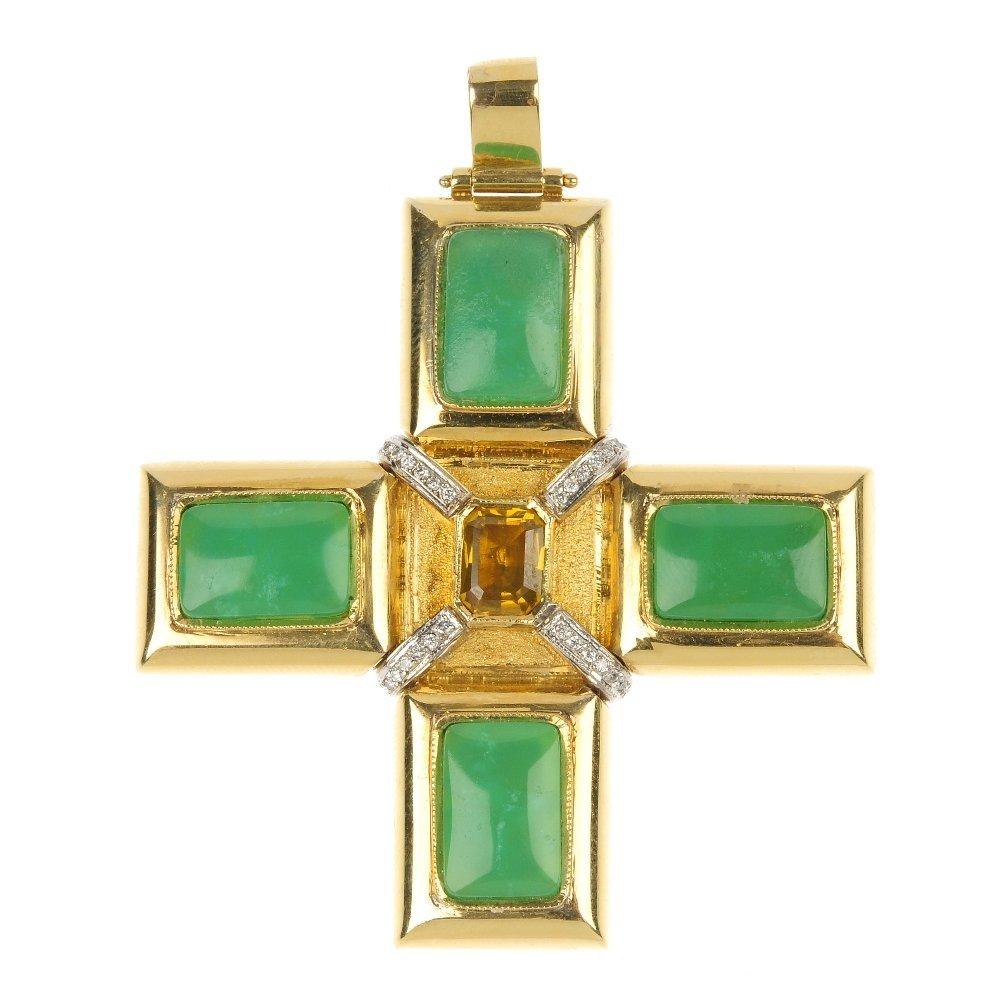 A diamond and gem-set cross pendant.