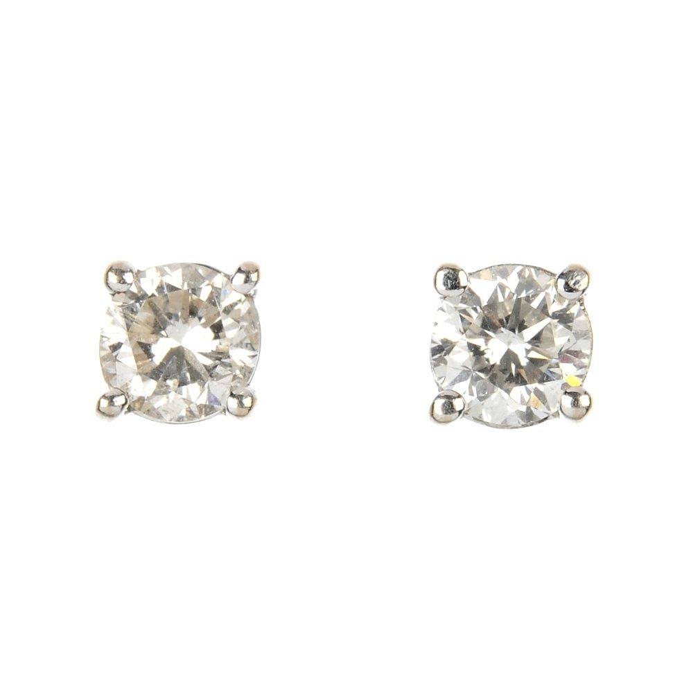 A pair of 18ct gold brilliant-cut diamond single-stone