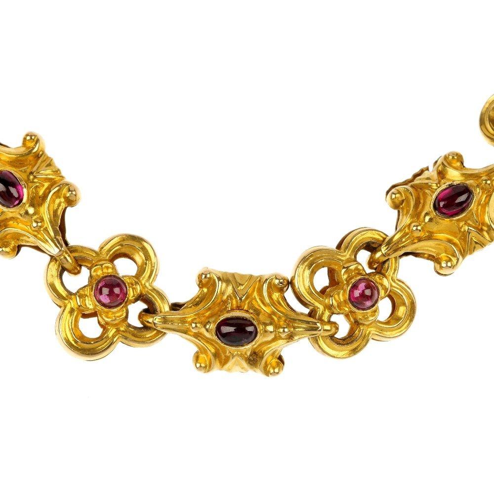 A late Victorian gold garnet necklace, circa 1890.
