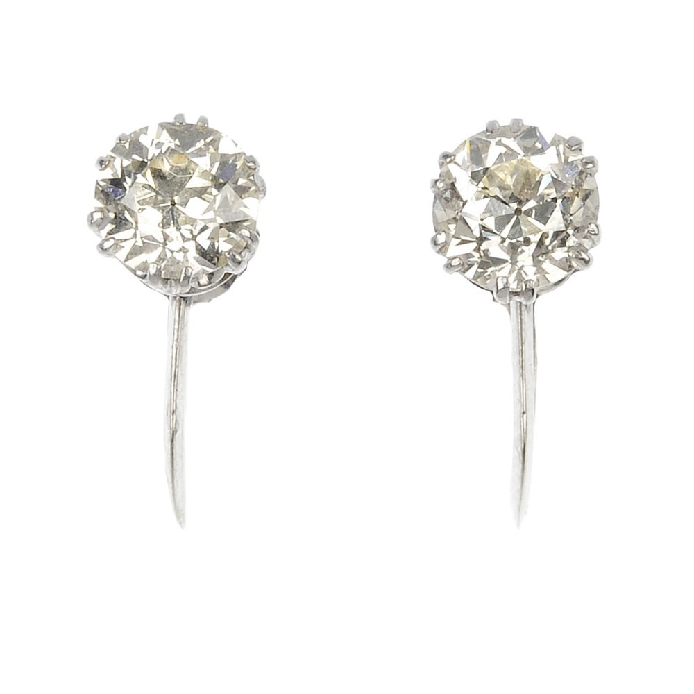 A pair of diamond single-stone earrings.