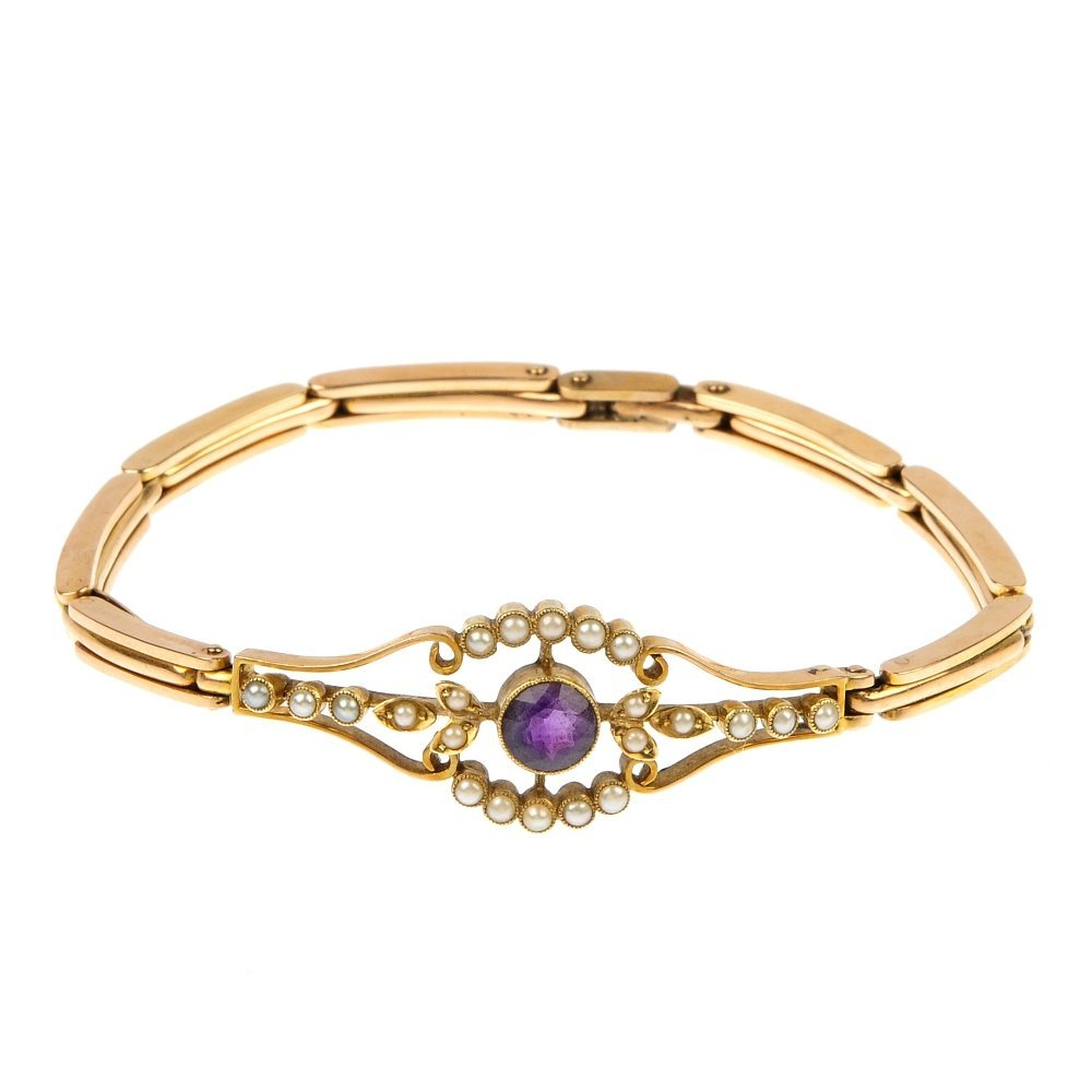 An early 20th century gold pearl and amethyst bracelet.