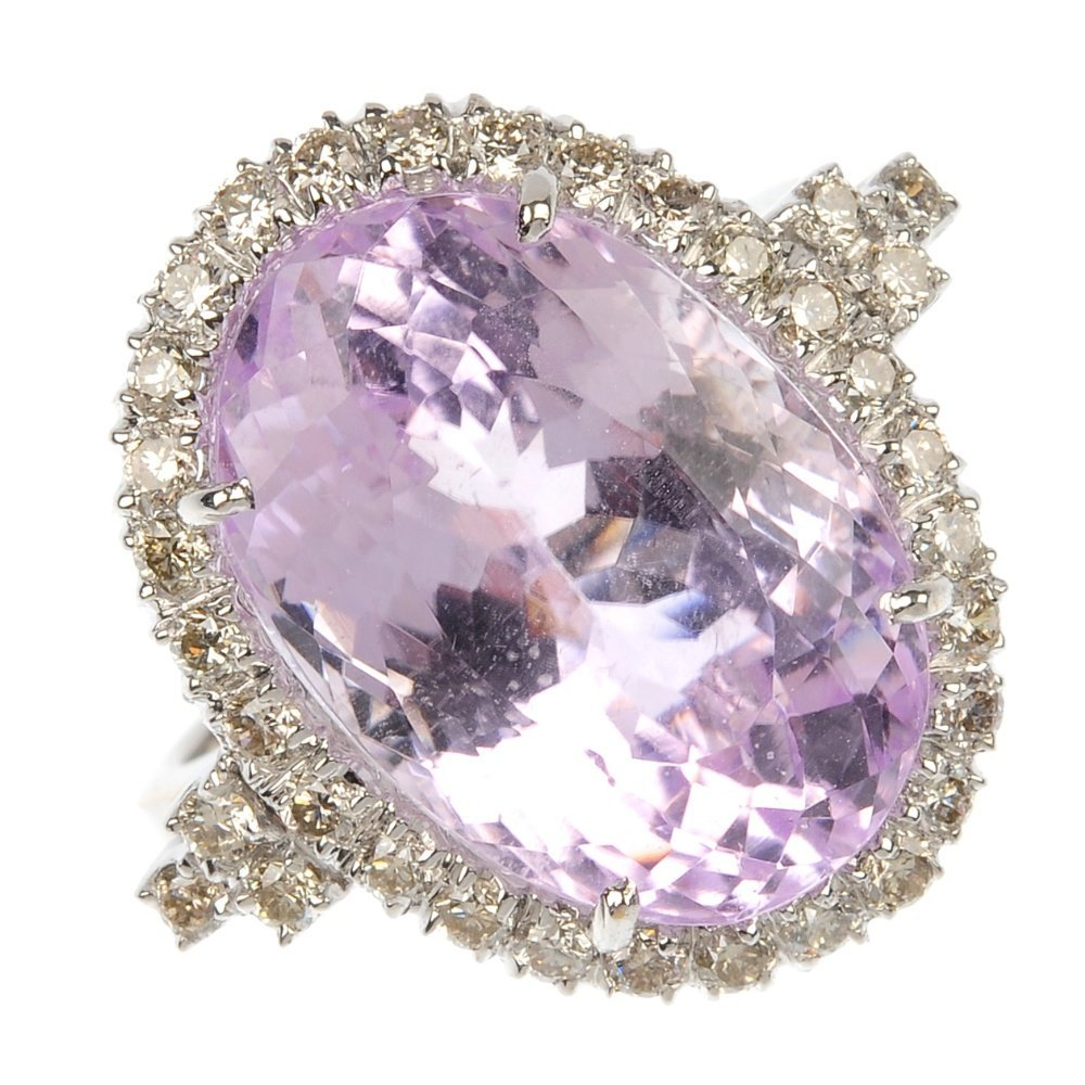 An 18ct gold kunzite and diamond cluster ring.