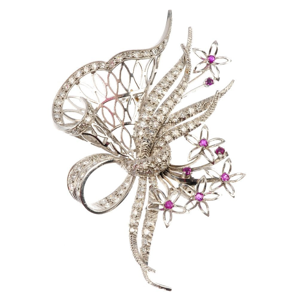 A mid 20th century diamond and ruby floral brooch.