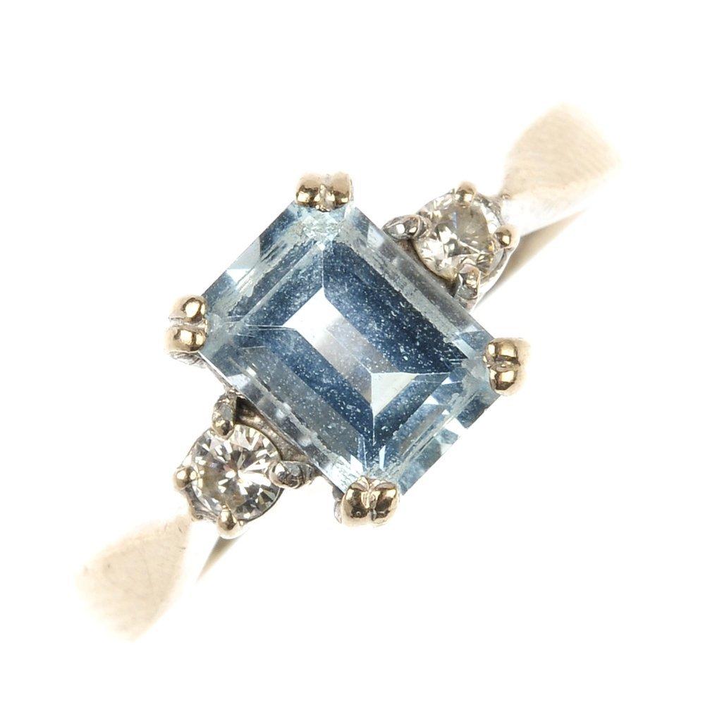 An 18ct gold aquamarine and diamond ring.