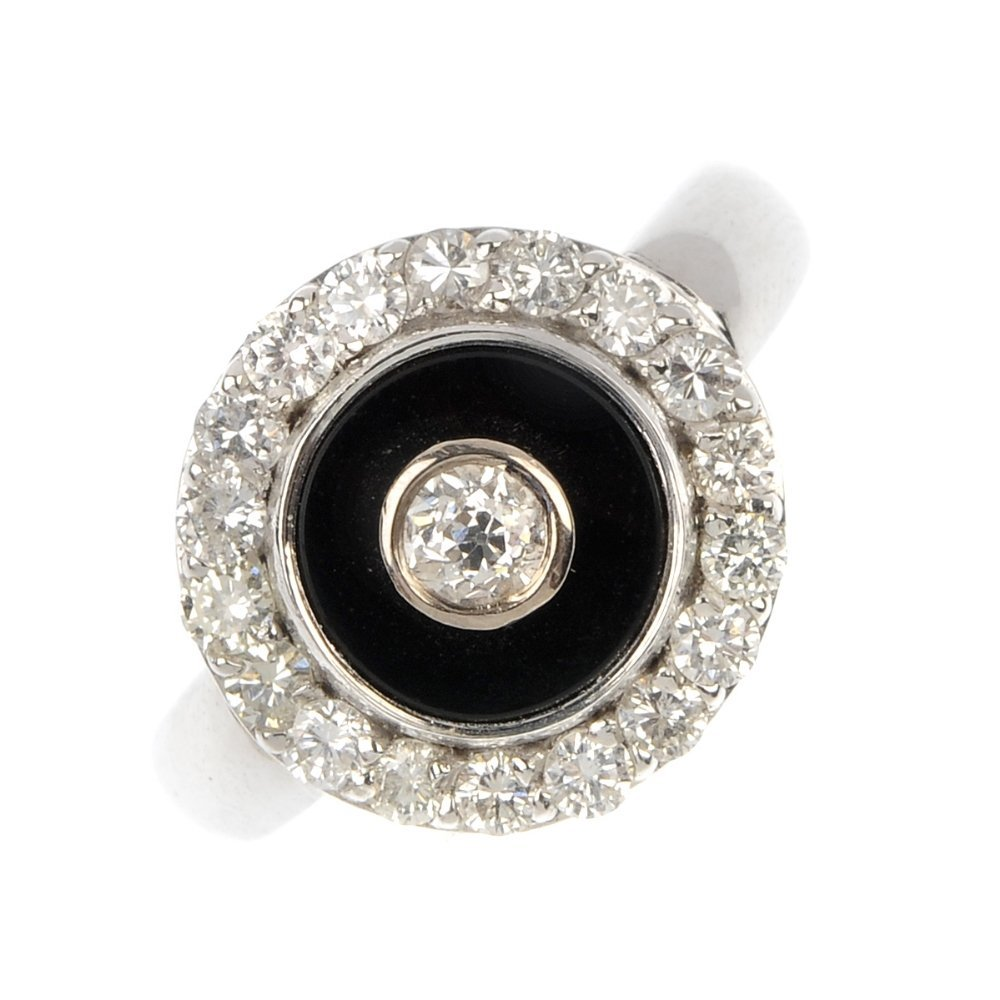 An 18ct gold diamond and onyx ring.