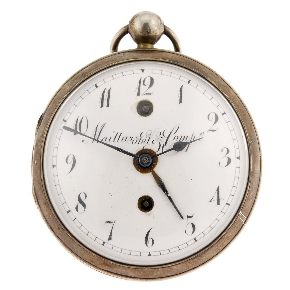 A continental white metal key wind open face alarm pock