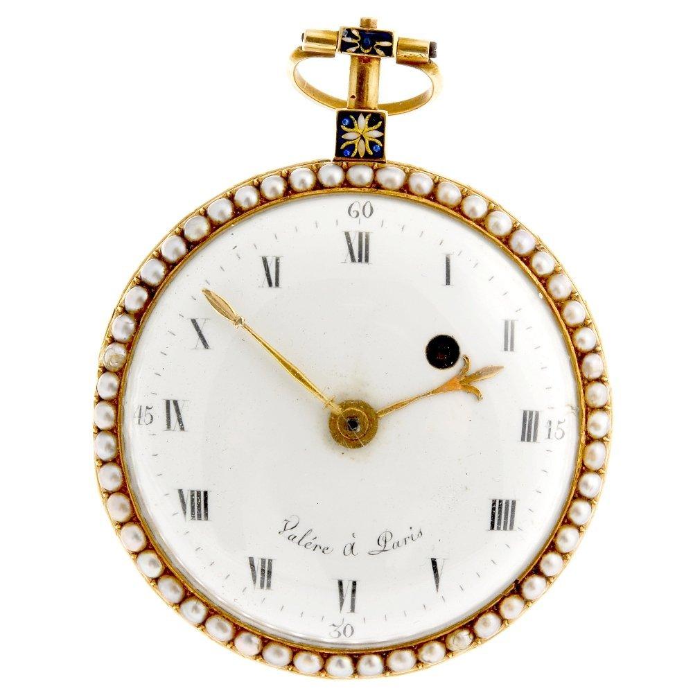 An yellow metal key wind open face pocket watch decorat