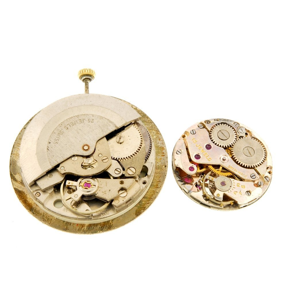 A group of assorted watch movements.