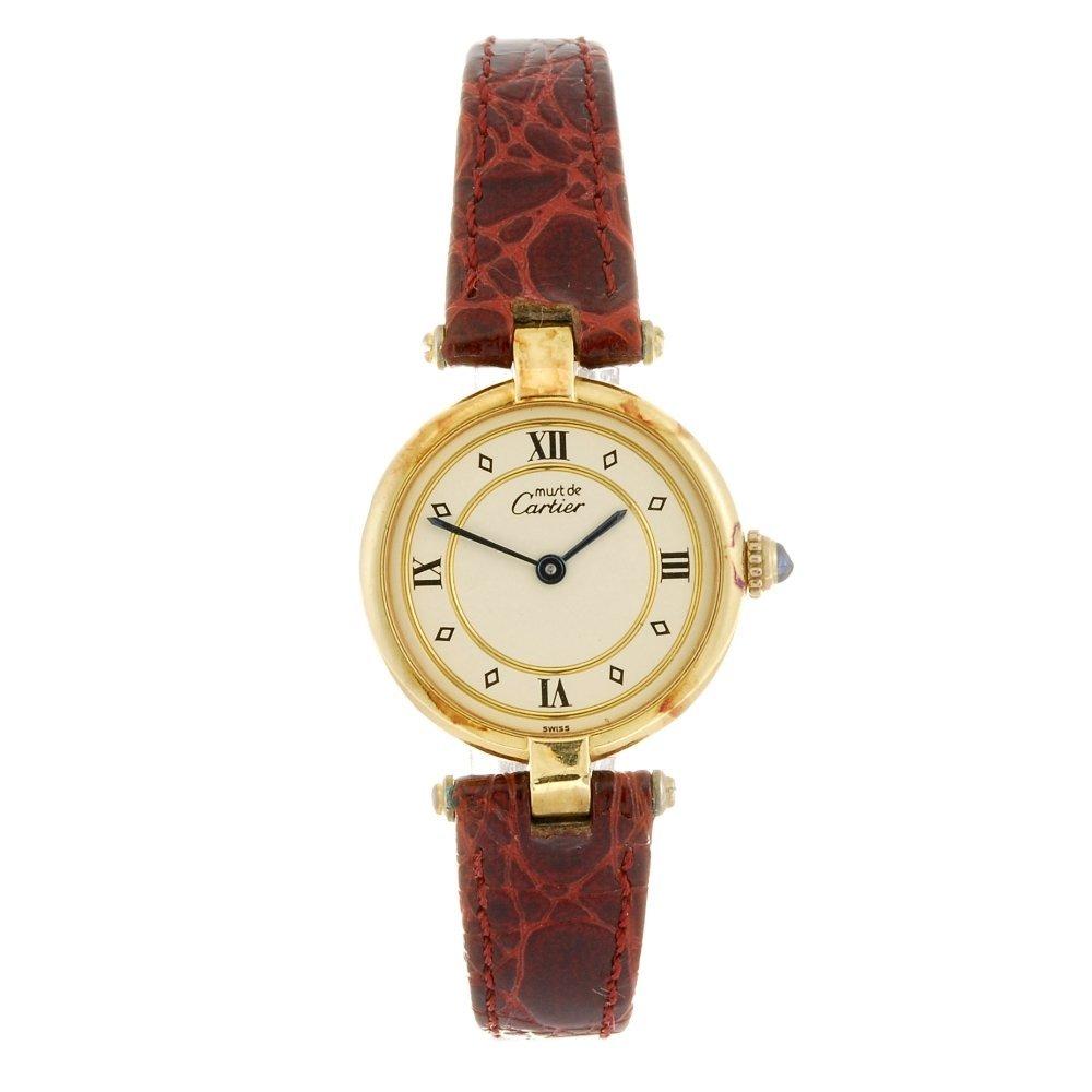 A gold plated quartz Cartier Vermeil wrist watch.