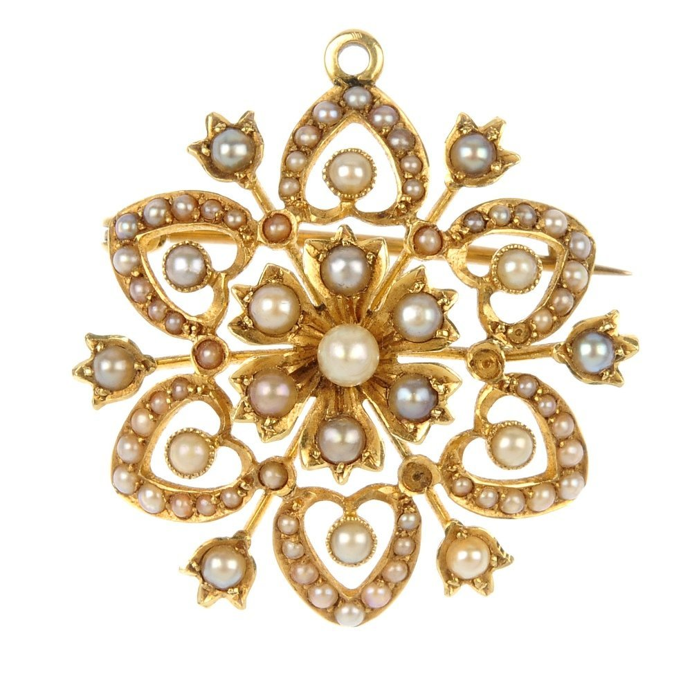 An early 20th century 15ct gold seed pearl floral brooc