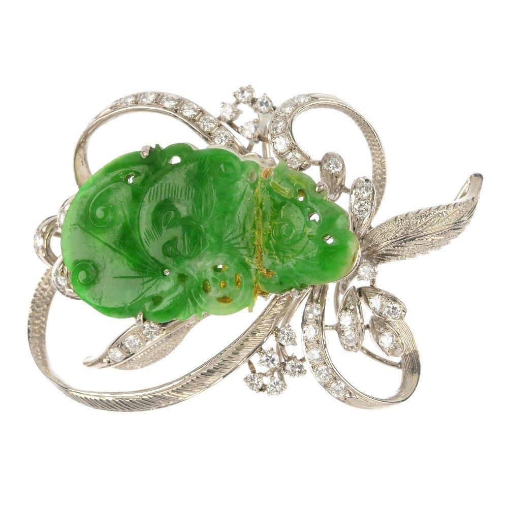 A jade and diamond brooch.