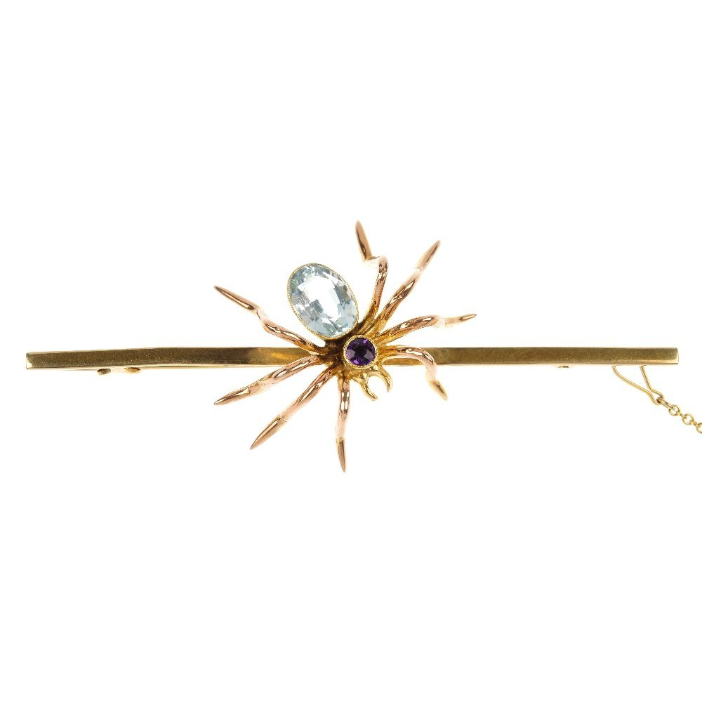 A mid 20th century aquamarine and amethyst spider brooc