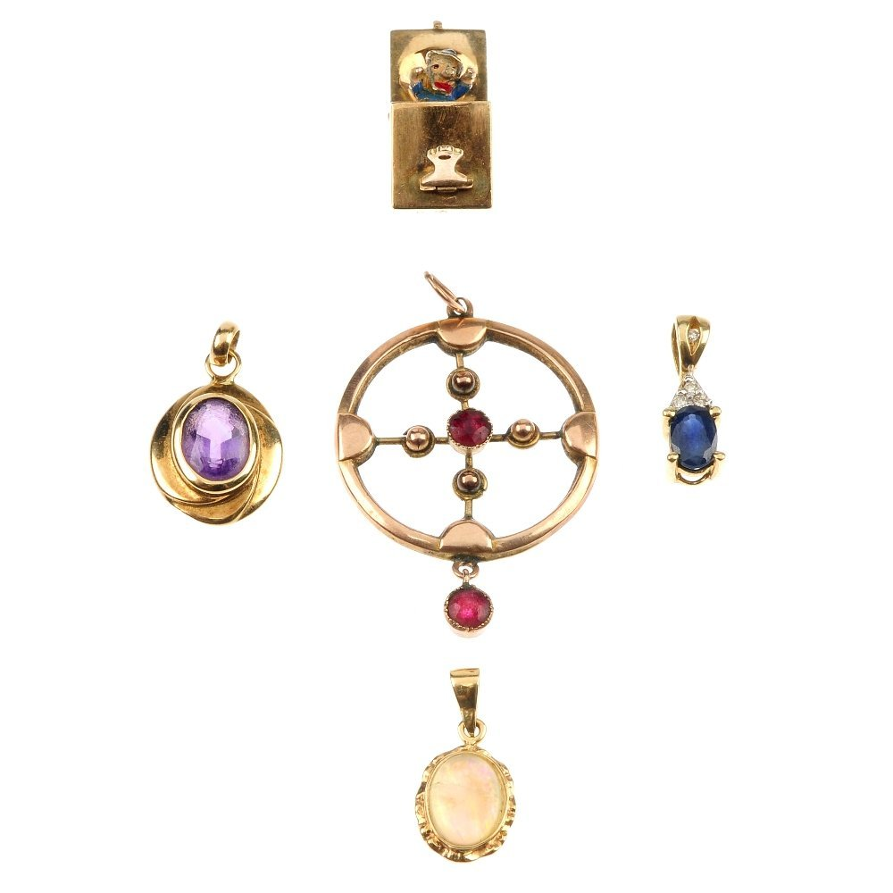A selection of four pendants and a charm.