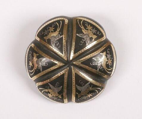 1: Circular domed tortoiseshell pique section