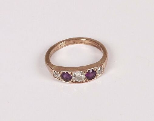 3: A boat shape ring set with three diamonds