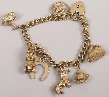 24: 9ct gold solid curb link bracelet with se