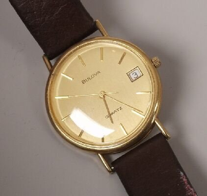 1008: BULOVA - a gentleman's 9ct yellow gold