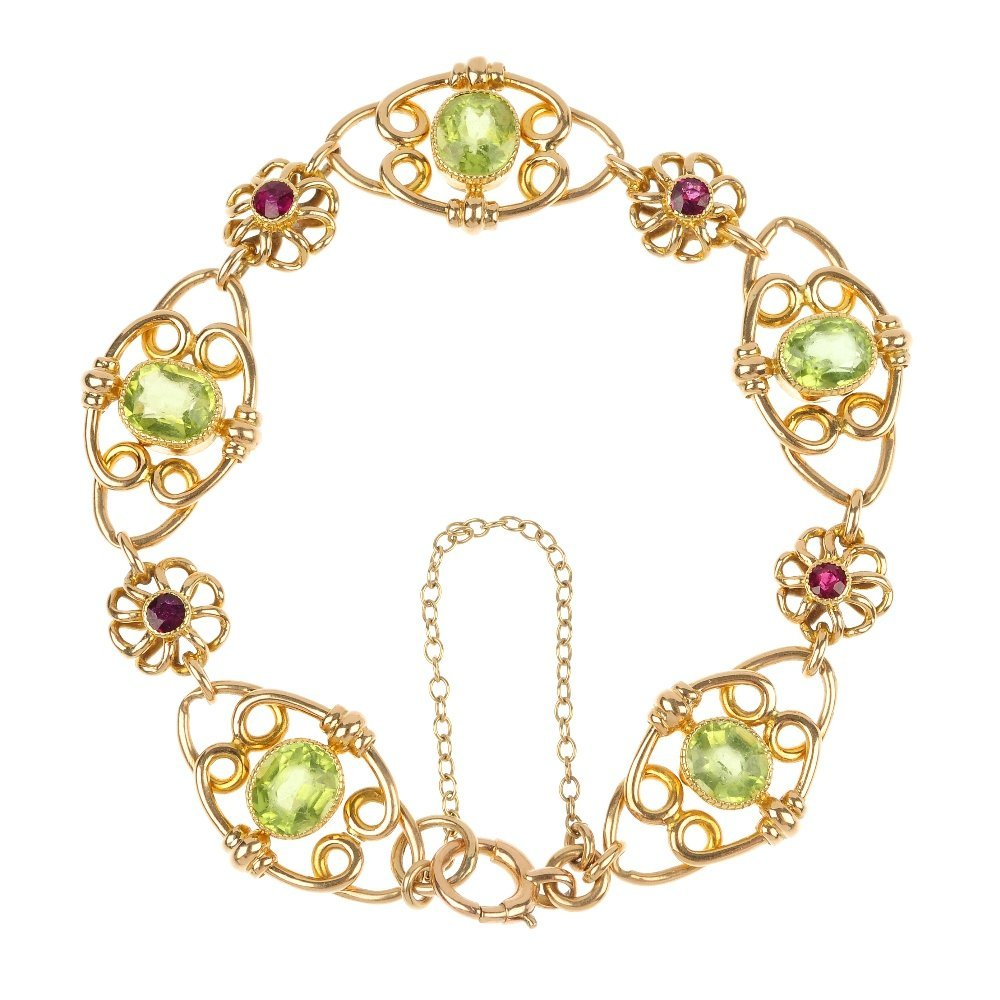 An early 20th century 15ct gold peridot and garnet