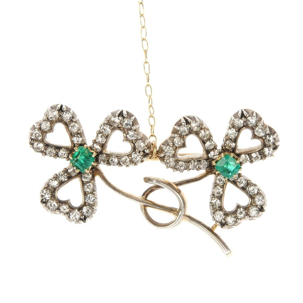 An early 20th century gold emerald and diamond brooch.