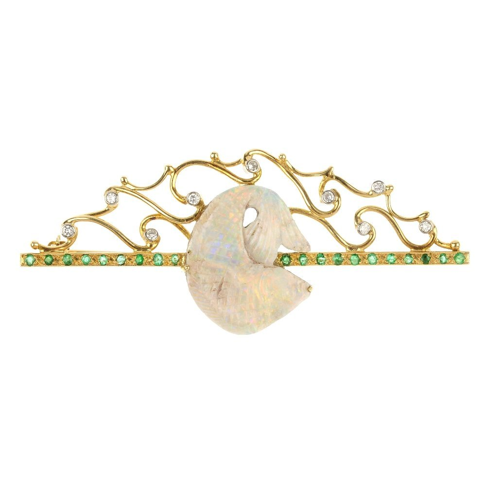 An 18ct gold carved opal emerald and diamond brooch.