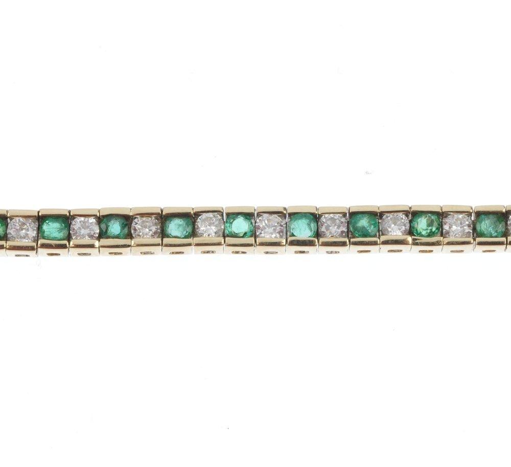 An emerald and diamond line bracelet.