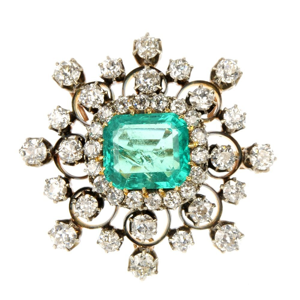 A late Victorian silver and gold emerald and diamond