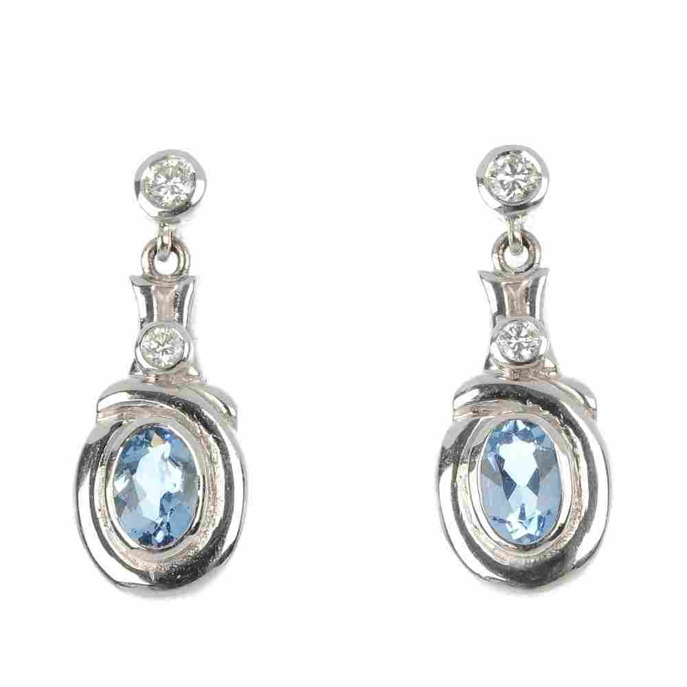 A pair of 18ct gold aquamarine and diamond earrings.