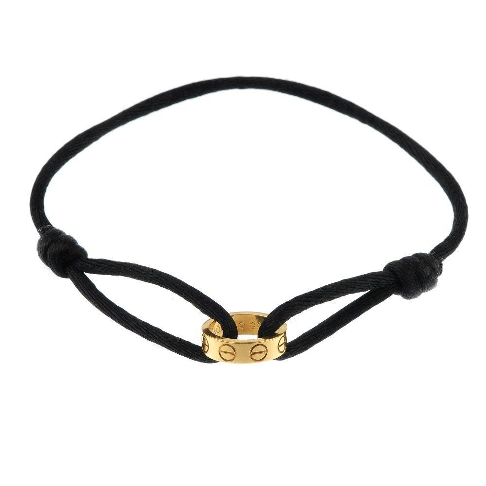 CARTIER - a cord bracelet.