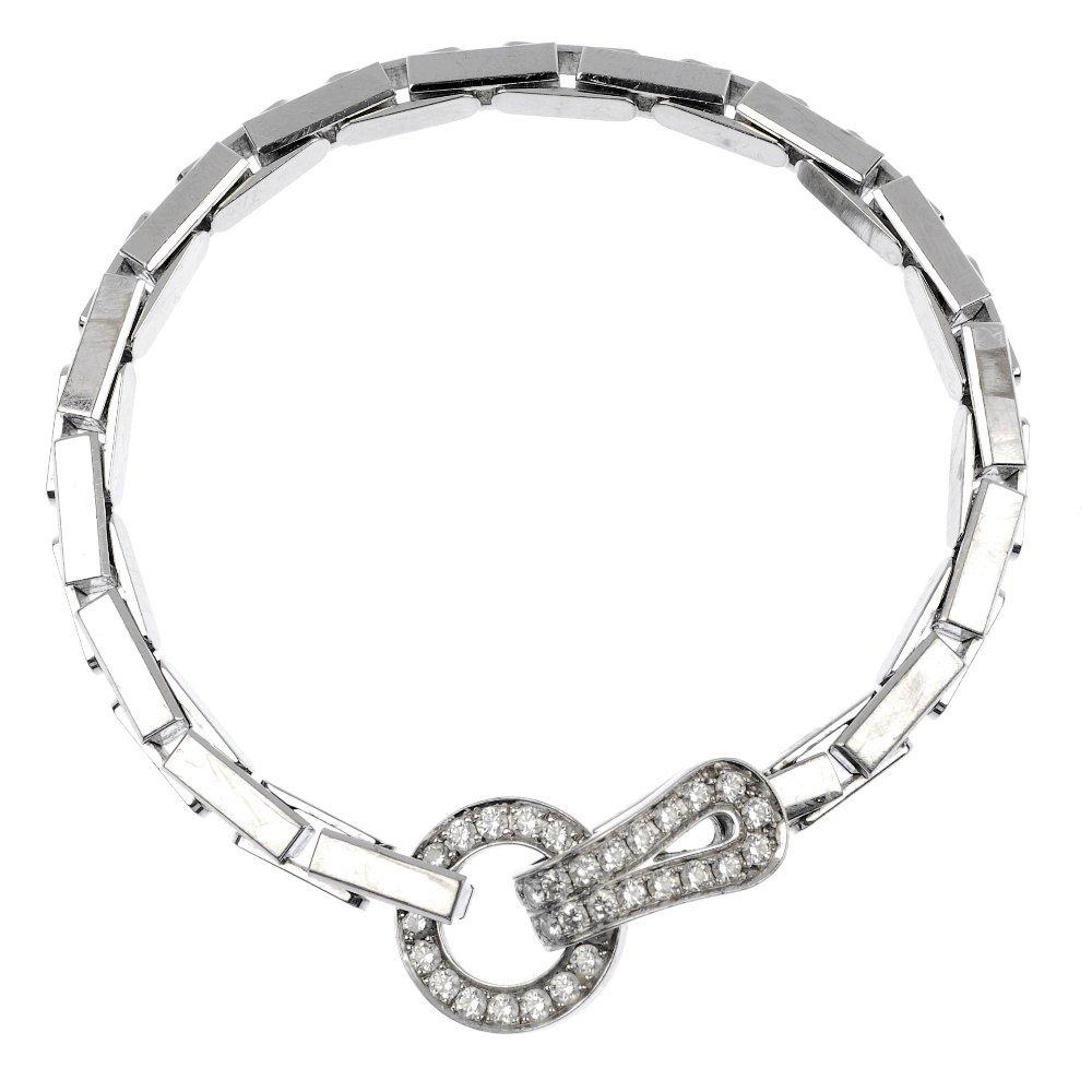 CARTIER - an 18ct gold diamond 'Agrafe' bracelet.