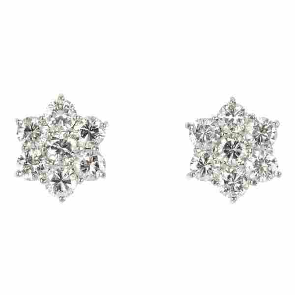 A pair of 18ct gold diamond cluster floral ear studs.