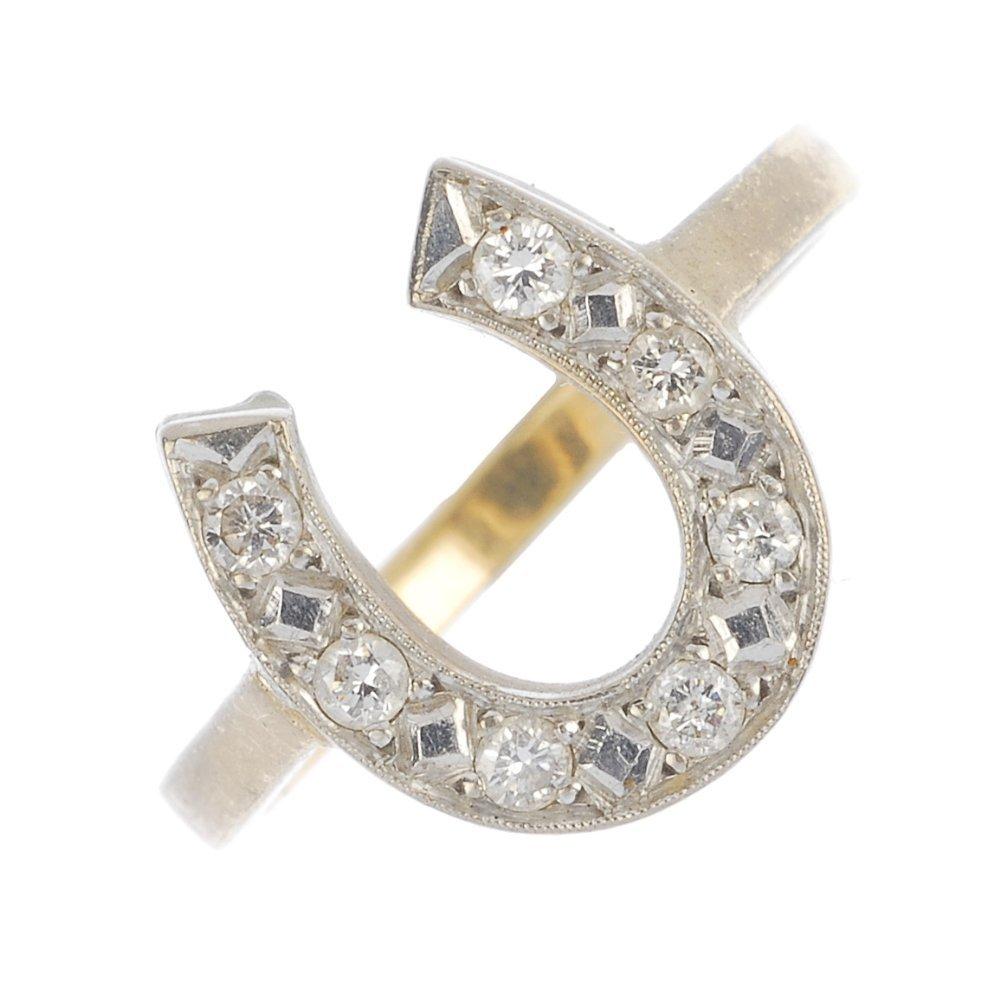 A diamond horseshoe ring.