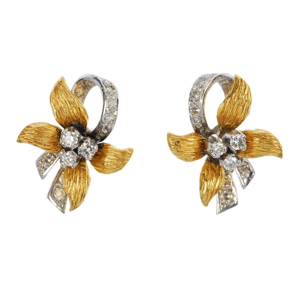 A pair of 1970s 18ct gold diamond floral earrings.
