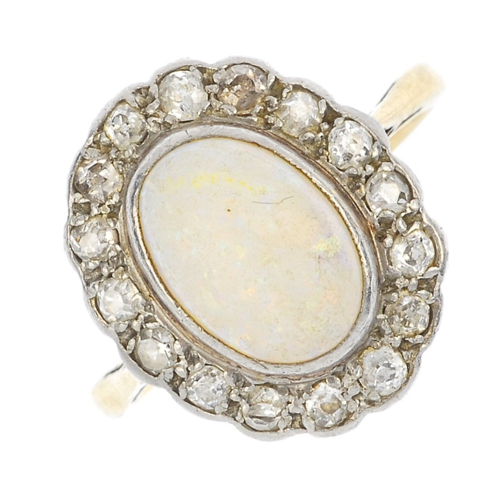 A mid 20th century 18ct gold opal and diamond cluster