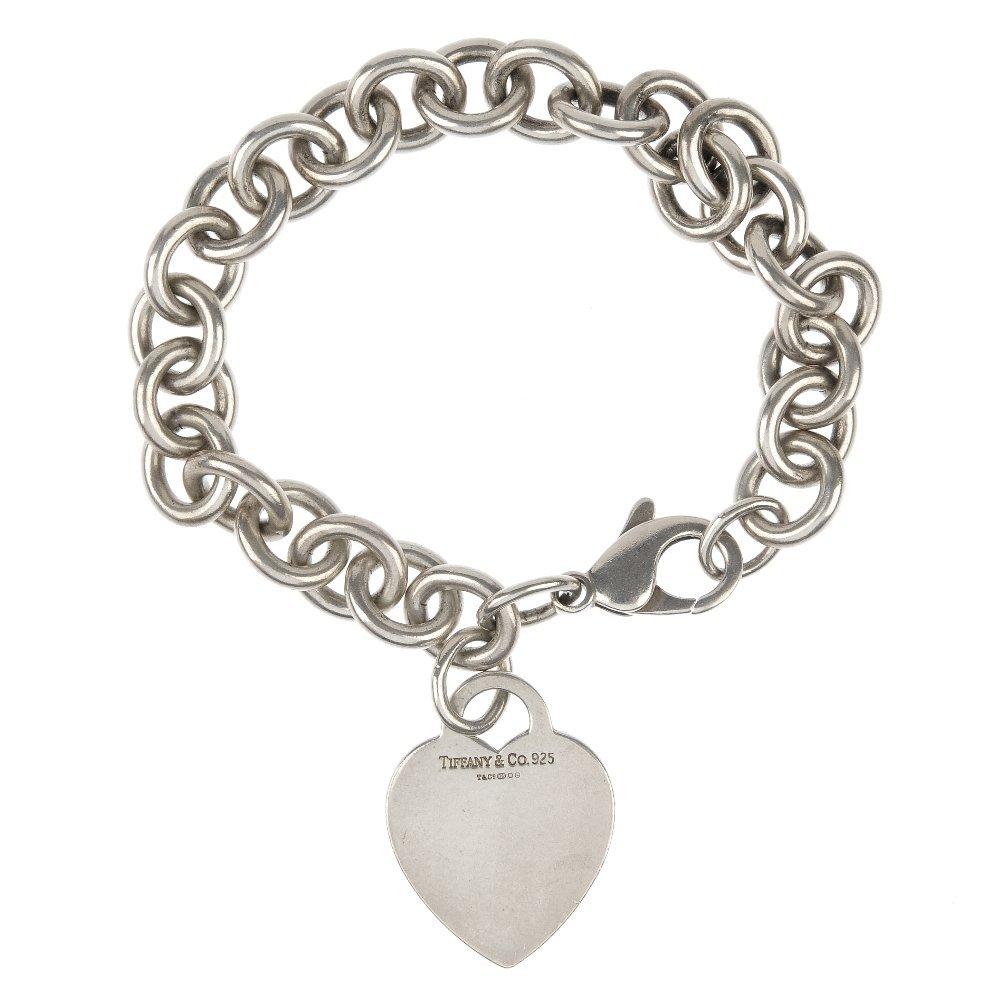 TIFFANY & CO. - a silver 'Heart tag' charm bracelet.