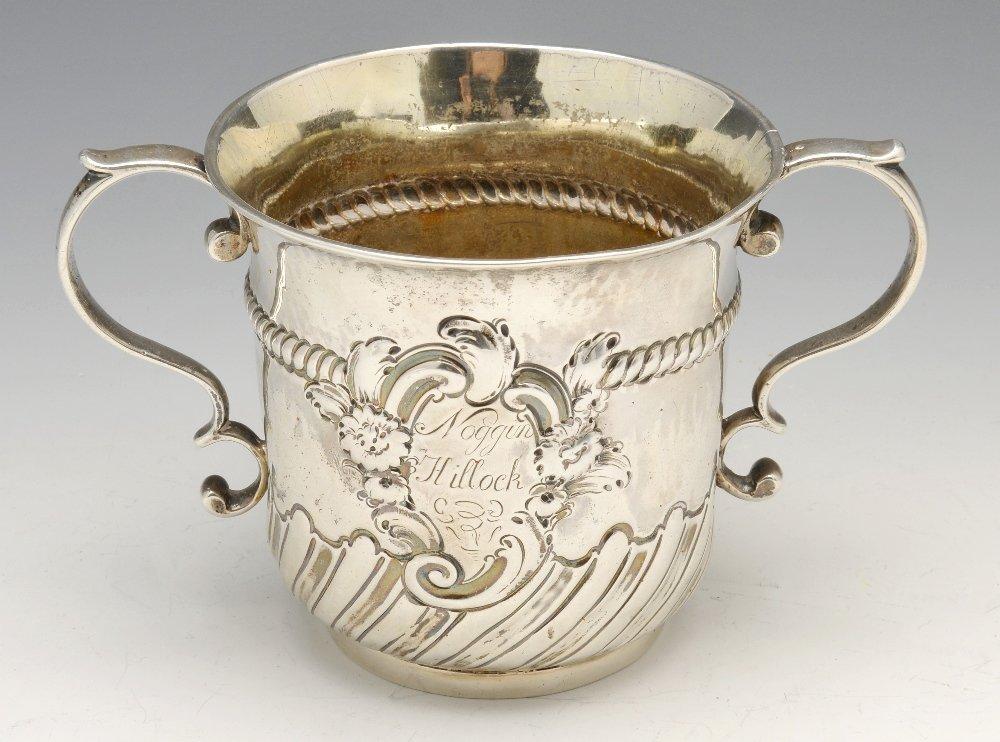 A George II silver porringer.