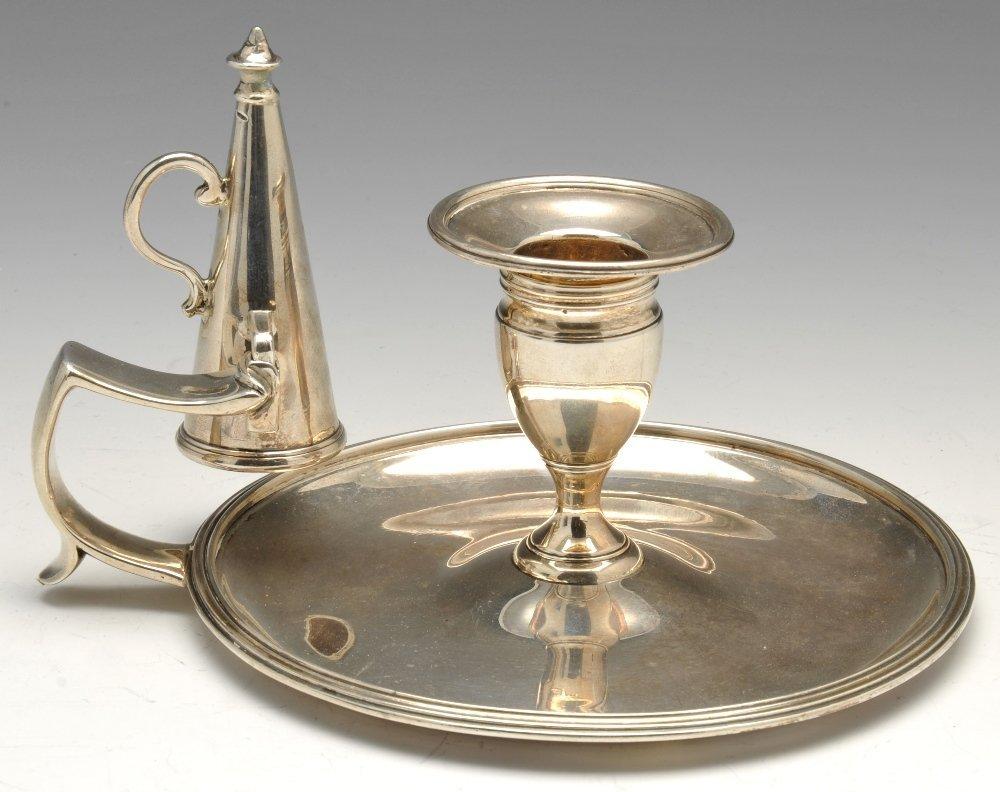 A George III silver chamberstick.