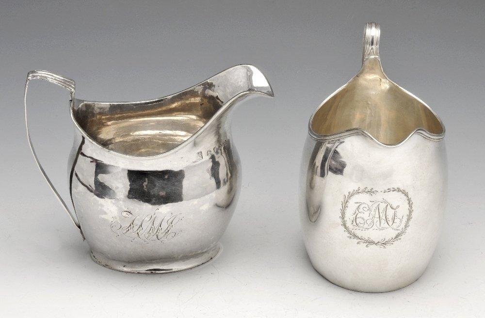 Two George III silver cream jugs.
