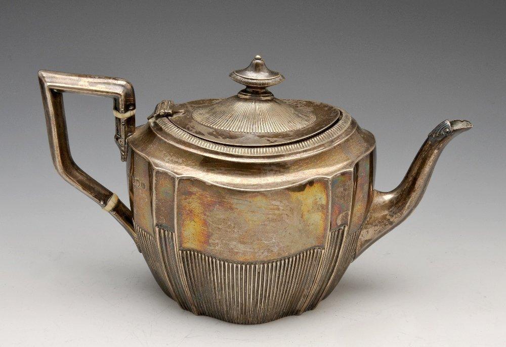 A Victorian silver teapot.